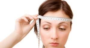 Fita métrica na cabeça