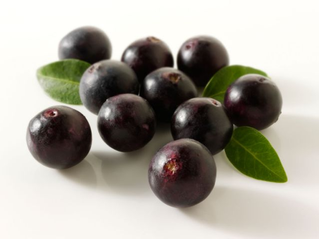 Acai Berries anti oxident fruit loose on a white background read