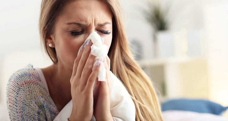 Espirro de alergia