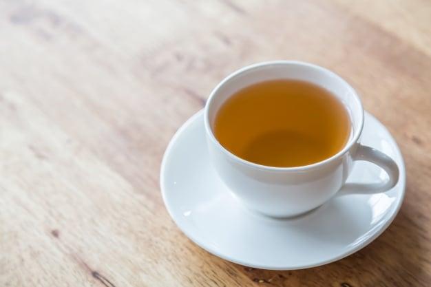 chá de noz da índia