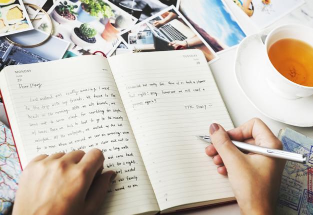 escrevendo no diário