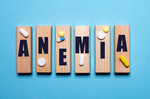 anemia escrita em madeira